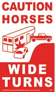 CAUTION HORSES WIDE TURNS sign